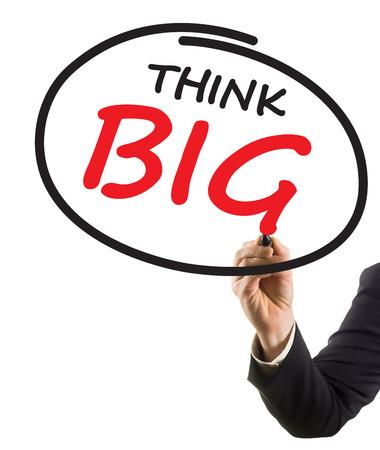 businessman hand writing text think big photo