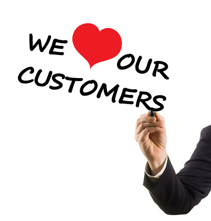 businessman hand writing text we love our customers photo