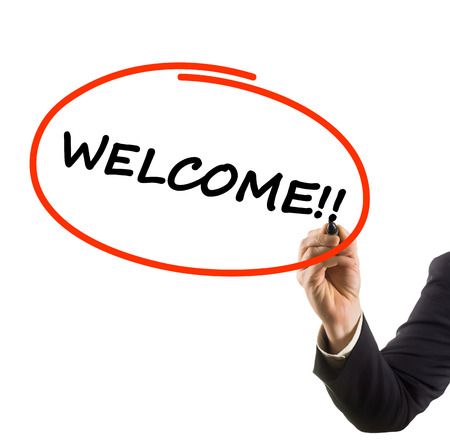 businessman hand writing text welcome photo