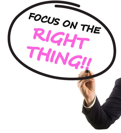 felt tip: businessman hand with felt tip marker writing text focus on right thing Stock Photo