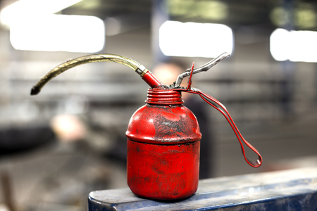red oil can in production hall photo