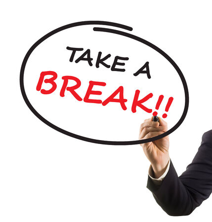 businessman hand with felt tip marker writing text take a break photo