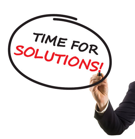 felt tip: businessman hand with felt tip marker writing text time for solutions
