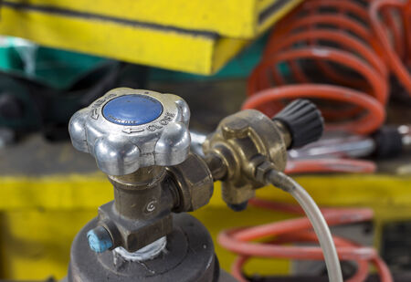 gas tank valve close up photo