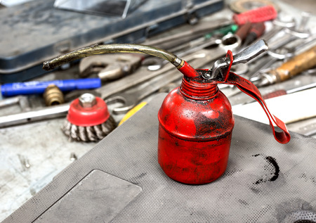 oil can on workbench with tools photo
