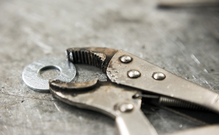 pincers on workbench close up Stock Photo
