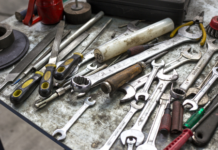 working tools on metal table photo