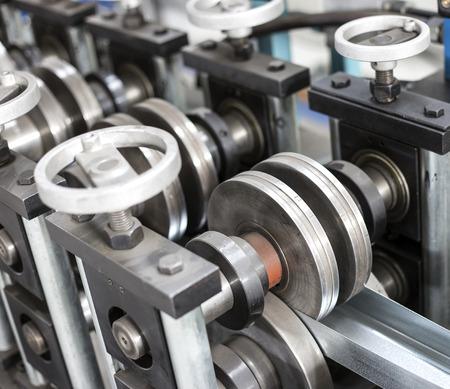 sheet tin metal profiles production machine close up photo