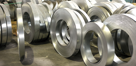 sheet tin metal rolls in production hall photo