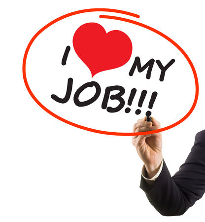 businessman hand with felt tip marker writing text I love my job with heart shape