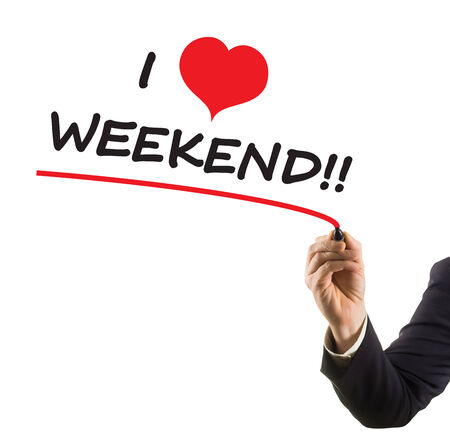 felt tip: businessman hand with felt tip marker writing text I love weekend with heat shape Stock Photo