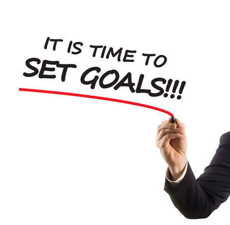 felt tip: businessman hand with felt tip marker writing text it is time to set goals