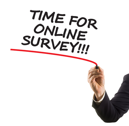 felt tip: businessman hand with felt tip marker writing text time for online survey