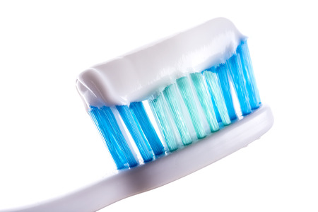 toothbrush with toothpaste on white background photo