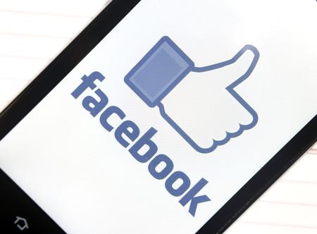 BELGRADE - FEBRUARY 06, 2014: Logo of popular social media website Facebook on smart phone screen