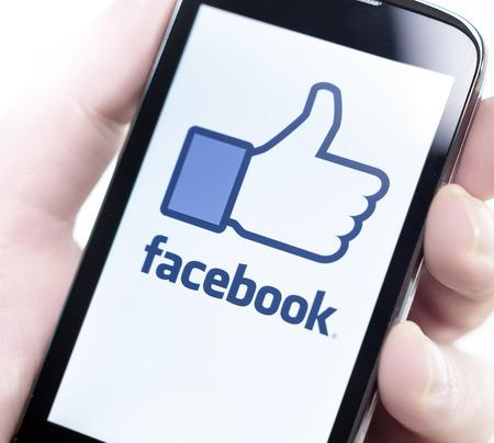 BELGRADE - FEBRUARY 07, 2014: Logo of popular social media website Facebook on smart phone screen