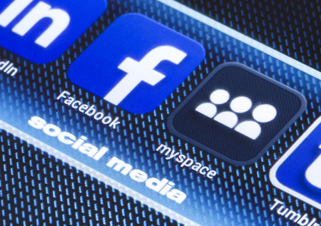 myspace: BELGRADE - JULY 11, 2014 Popular social media icons facebook myspace and other on smart phone screen close up Editorial