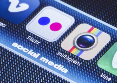 flickr: BELGRADE - JULY 11, 2014 Popular social media icons flickr instagram and other on smart phone screen close up