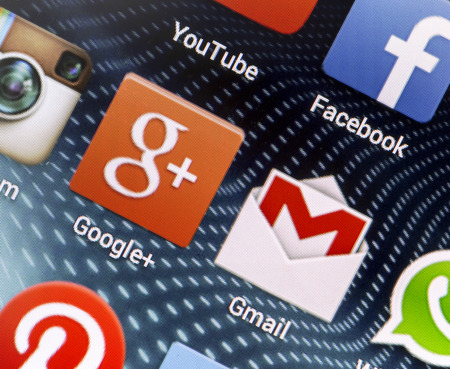 BELGRADE - APRIL 26, 2014 Popular social media icons Google+, Gmail and other on smart phone screen close up