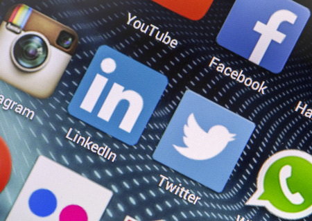BELGRADE - APRIL 26, 2014 Popular social media icons Linkedin, Twitter and other on smart phone screen close up