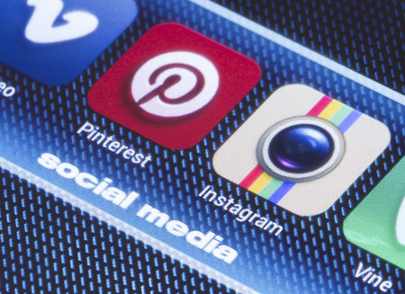 BELGRADE - JULY 11, 2014 Popular social media icons pinterest instagram and other on smart phone screen close up