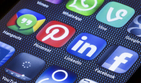 pinterest: BELGRADE - JULY 05, 2014 Popular social media icons linkedin pinterest and other on smart phone screen close up