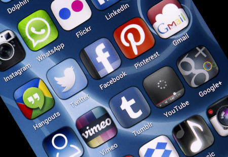 BELGRADE - JUNE 30, 2014 Popular social media icons Twitter, Facebook and other on smart phone screen Editorial