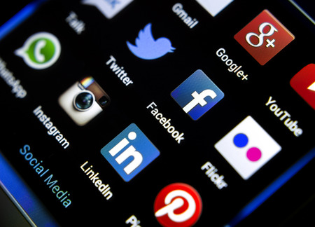 BELGRADE - FEBRUARY 04, 2014: Popular social media icons on smart phone screen