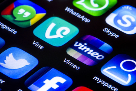 gmail: BELGRADE - JUNE 23, 2014 Popular social media icons vine vimeo  and other on smart phone screen close up