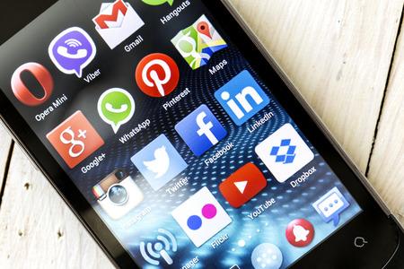BELGRADE - MAY 03, 2014 Popular Social media icons on smart phone screen
