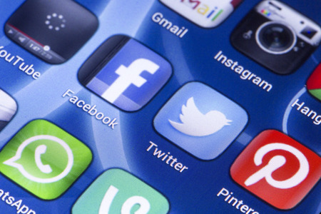 BELGRADE - MAY 28, 2014 Social media icons Facebook, Twitter and other on smart phone screen close up Editorial