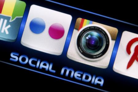 flickr: BELGRADE - SEPTEMBER 09, 2014 Social media icons Flickr and Instagram on smart phone screen close up