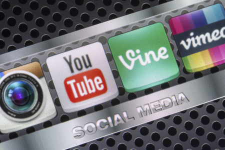 vimeo: BELGRADE - AUGUST 30, 2014 Social media icons Youtube, Vimeo, Vine and other on smart phone screen close up