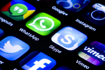 BELGRADE - JUNE 23, 2014 Popular social media icons whatsapp skype and other on smart phone screen close up