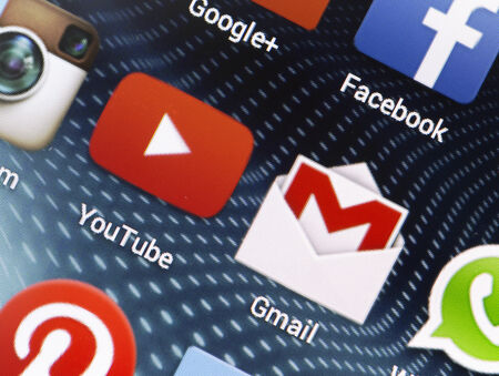 gmail: BELGRADE - APRIL 26, 2014 Popular social media icons Youtube, Gmail and other on smart phone screen close up Editorial