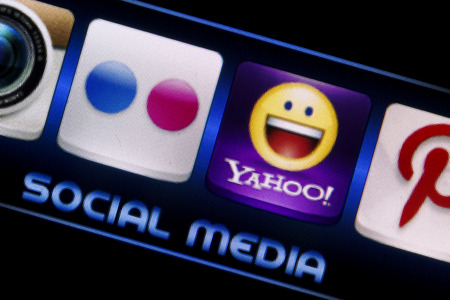 livejournal: BELGRADE - SEPTEMBER 09, 2014 Social media icons Flickr and Yahoo on smart phone screen close up