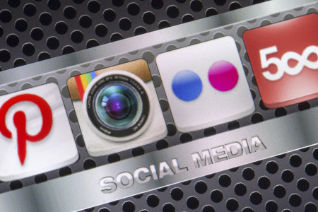 flickr: BELGRADE - AUGUST 30, 2014 Social media icons Instagram Flickr and other on smart phone screen close up Editorial