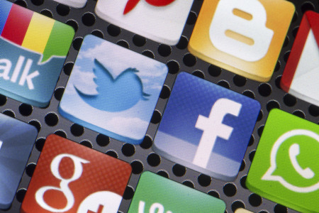 BELGRADE - AUGUST 30, 2014 Social media icons Twitter, Facebook and other on smart phone screen close up