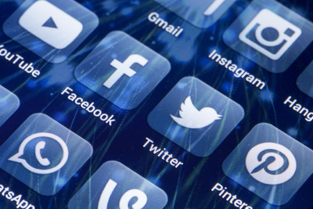 28: BELGRADE - MAY 28, 2014 Social media icons Facebook, Twitter and other on smart phone screen Editorial