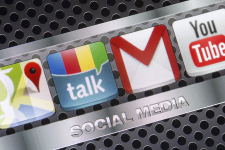 BELGRADE - AUGUST 30, 2014 Social media icons Google talk, google mail and other on smart phone screen close up