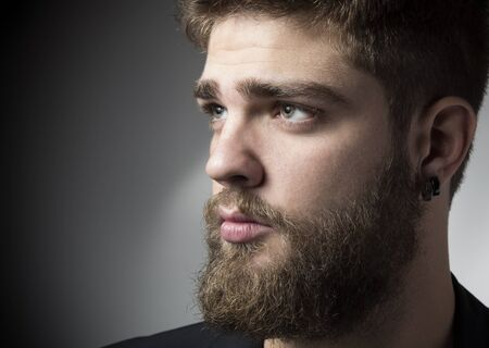Young man with beard close up portrait