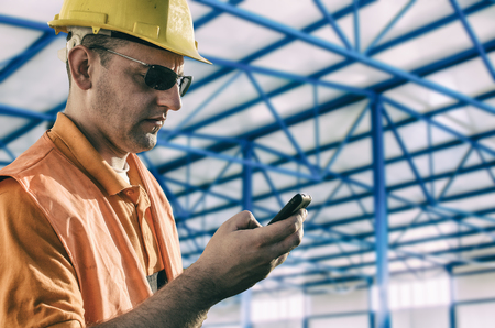 muff: Worker in protective uniform in production hall Stock Photo