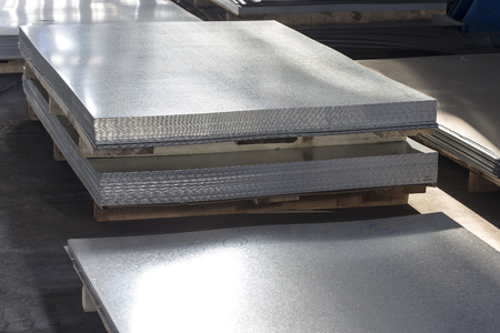 metal sheet: sheet tin metal in production hall
