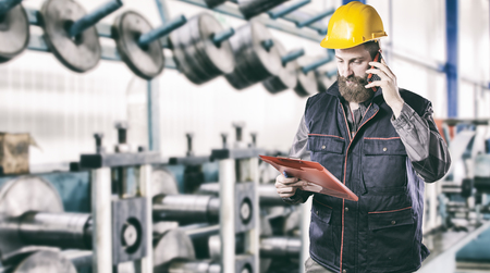 ear muff: worker with protective uniform in front of production machine