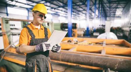 extrusion: worker with protective uniform in production hall  Stock Photo