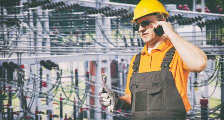 ear muff: worker with protective uniform in front of power plant  Stock Photo