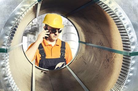 steel sheet: worker seen through a steel sheet metal roll