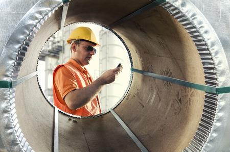 worker seen through a steel sheet metal roll