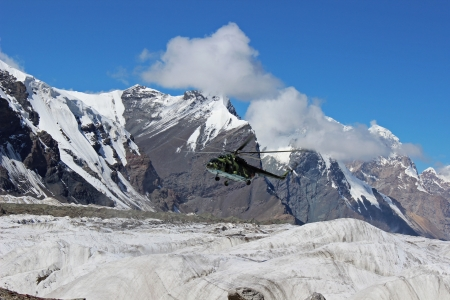 Soviet helicopter with climbers landing at Khan Tengri and Pobeda Peak base camp  (Kyrgyzstan )