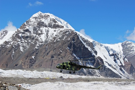 Soviet helicopter with climbers landing at Khan Tengri and Pobeda Peak base camp  (Kyrgyzstan ) Stock Photo - 17069779
